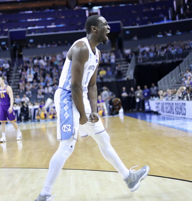Theo Pinson celebrates after scoring a basket through contact for an and-1 opportunity. The senior forward finished the game just three assists shy of a triple double | Photo by Caleb Jones