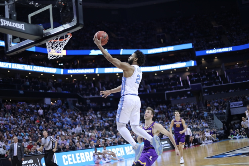 Joel Berry finishes his layup after going coast to coast off a steal. The senior guard played 37 minutes and added two three pointers to his team's efforts. | Photo by Caleb Jones.