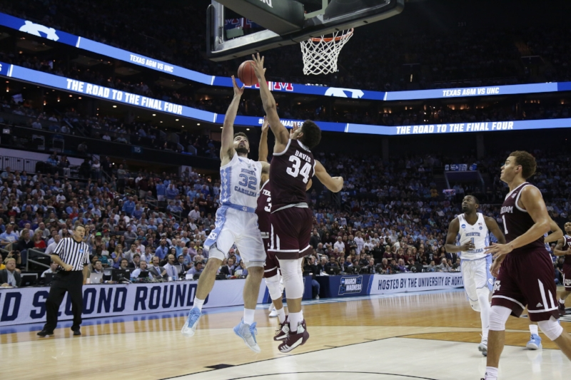 Luke Maye has a shot swatted away by Texas A&M's Ryan Davis. The Tar Heels struggled all night to get inside, forcing guards to fire away from beyond the arc. | Photo by Gabi Palacio