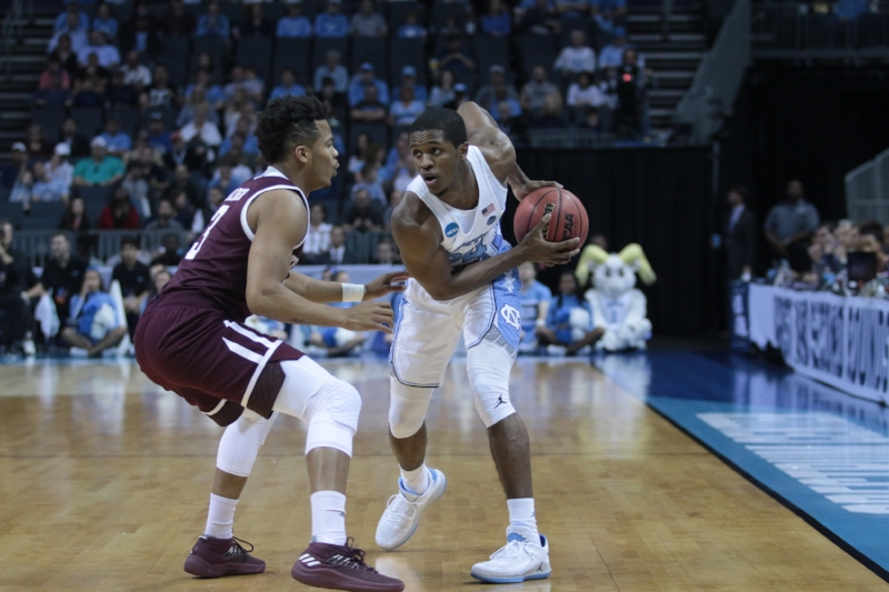 Kenny Williams goes into the triple threat position on the wing of the Tar Heel offense. Williams scored only five points against the Aggies on Sunday. | Photo by Gabi Palacio
