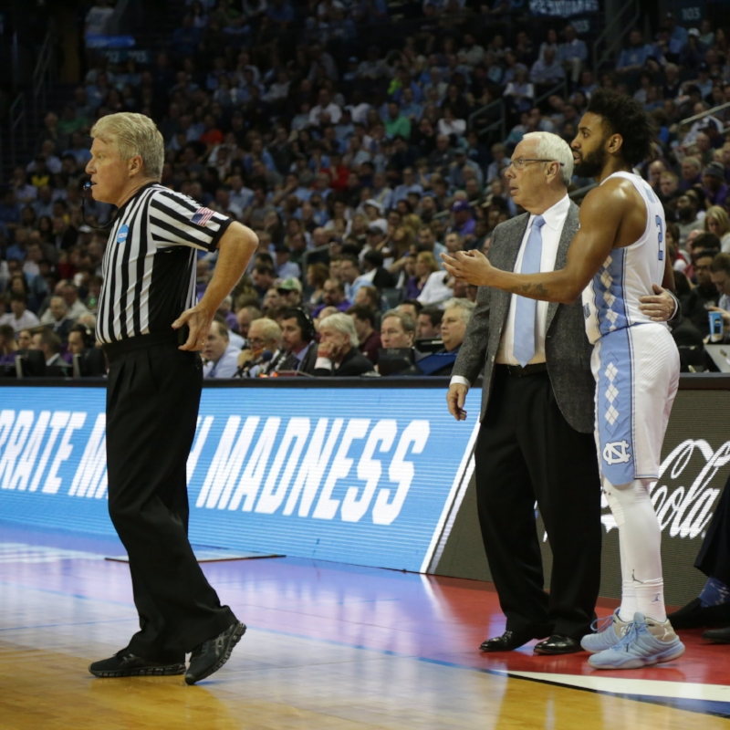 Joel Berry (2) and Roy Williams looked on for the entire second half, hoping UNC could cut into Texas A&M's sizable deficit. The Tar Heels never did, falling in the second round of the NCAA Tournament on Sunday. | Photo by Gabi Palacio