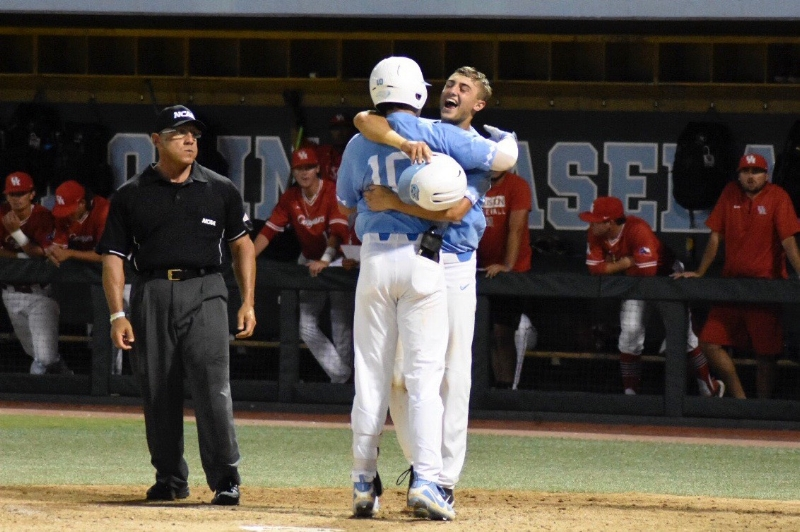 Zack Gahagan celebrates with Brandon Martorano after Gahagan's seventh inning home run. Gahagan made the all-regional team at second base after hitting two two-run jacks during the regional. | Photo by Turner Walston