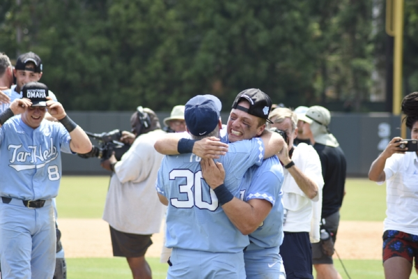 North Carolina teammates and coaches embrace after the win on Sunday                                                Photo by Turner Walston