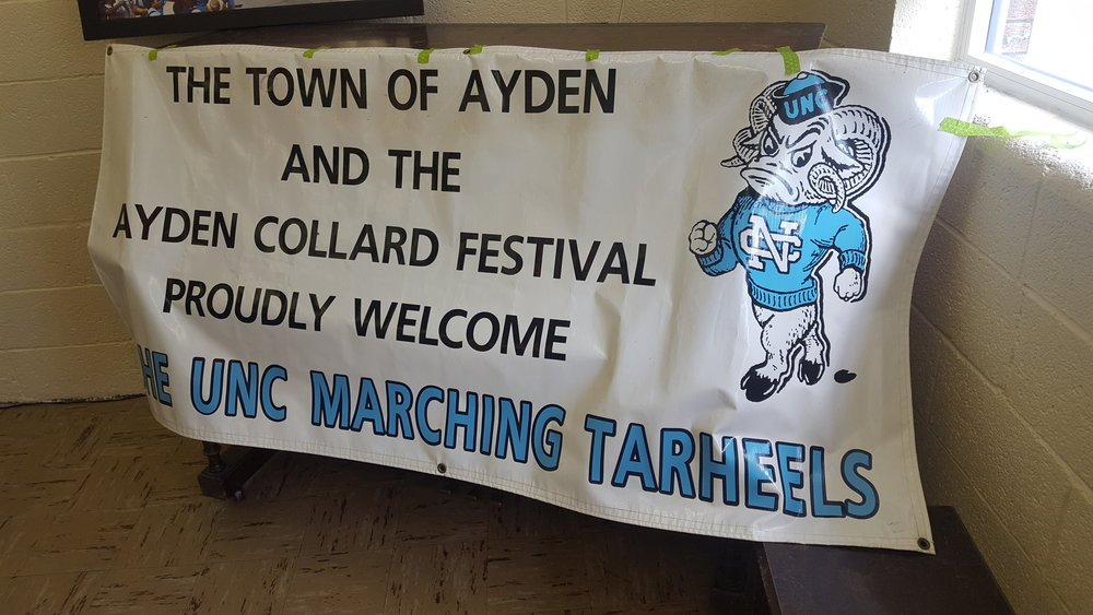 The original sign created in 2008 to welcome the Marching Tar Heels to Ayden, NC, for the town's Collard Festival. The sign was brought out on display when the band most recently visited prior to the ECU game. (Photo by Brighton McConnell)