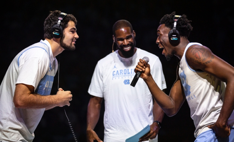 Luke Maye and Nassir Little try to pass long the message in Late Night with Roy's lip-reading game while host Antawn Jamison looks on. | Photo by Alex Kormann