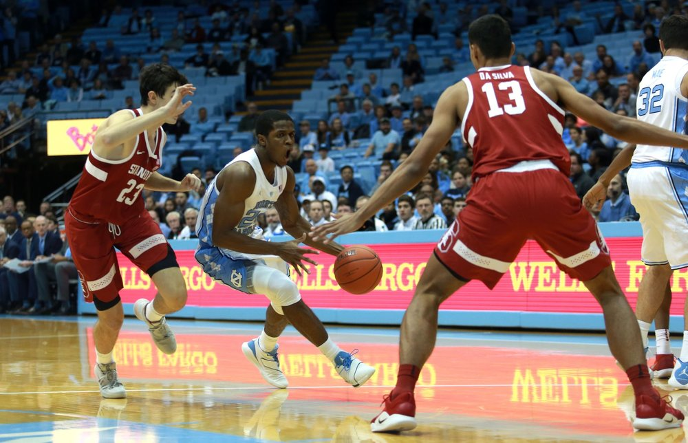 Kenny Williams drives to the basket in UNC's 90-72 win over Stanford (Photo: Alex Kormann)