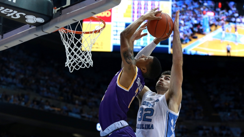Luke Maye goes up for a block against Jared Sherfield. The senior Tar Heel finished the night with one block, but led his teammates with 15 points and eight rebounds. | Photo by Alex Kormann.