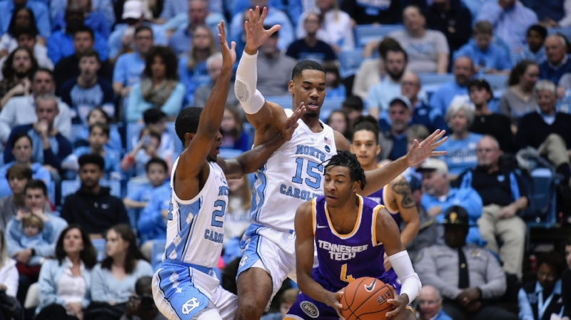 Kenny Williams and Garrison Brooks trap Jr. Clay of Tennessee Tech in the second half of UNC's 108-58 win on Friday Night. The Tar Heels had 16 steals on the night. | Photo by Alex Kormann