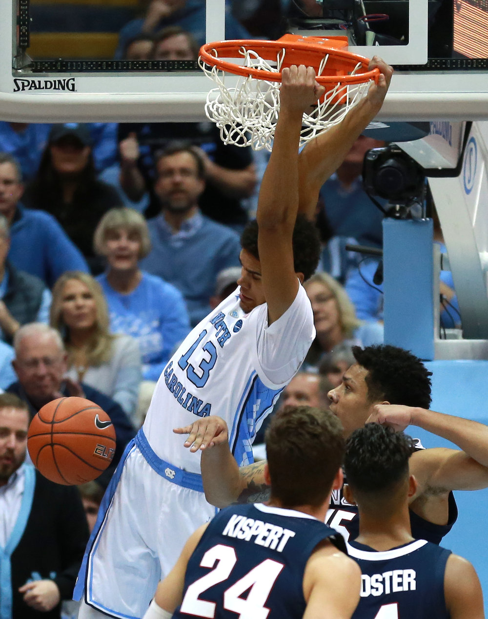 Cam Johnson slams home a dunk through traffic in the first half of Saturday's win over Gonzaga. The graduate transfer finished the night with 25 points. | Photo by Alex Kormann.