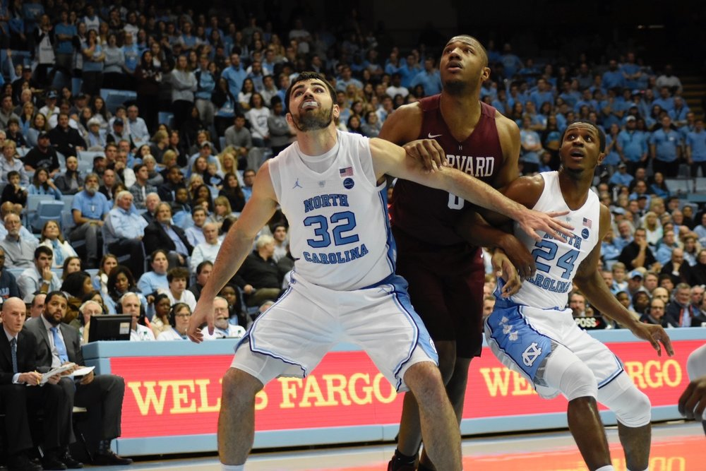 Luke Maye (32) boxes out on a free throw attempt in Wednesday's win against Harvard. The senior forward leads the Tar Heels with 9.8 rebounds a game as of publishing. | Photo by Turner Walston