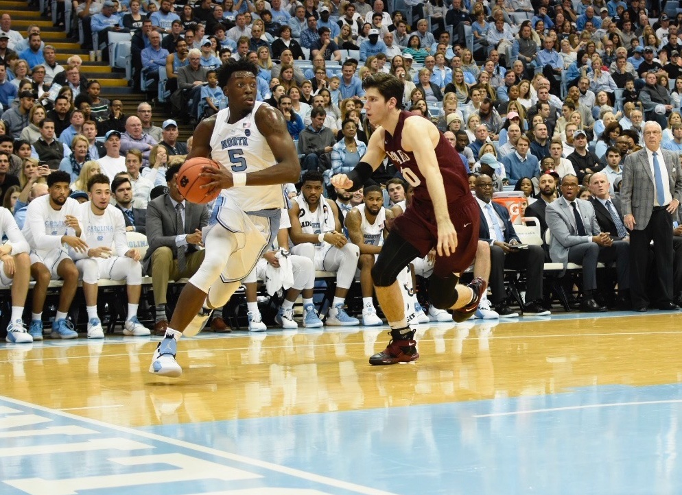 Nassir Little drives to the lane in the second half against Harvard. The freshman is the Tar Heels' top scorer off the bench, averaging 10.8 points per game in just 19.5 minutes a game. | Photo by Turner Walston