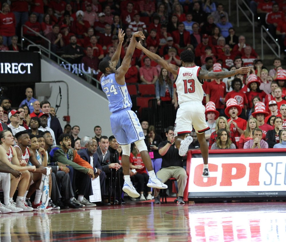 Kenny Williams takes a three-point shot in the first half against N.C. State. The senior guard finished with 15 points and 10 rebounds, his first collegiate double-double.   Photo by Turner Walston.