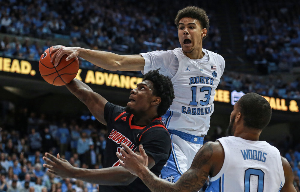 Cameron Johnson goes in for a block during Saturday's loss to Louisville. The graduate transfer forward scored ten points against the Cardinals, but failed to drain a three for the first time this season. | Photo by Alex Kormann