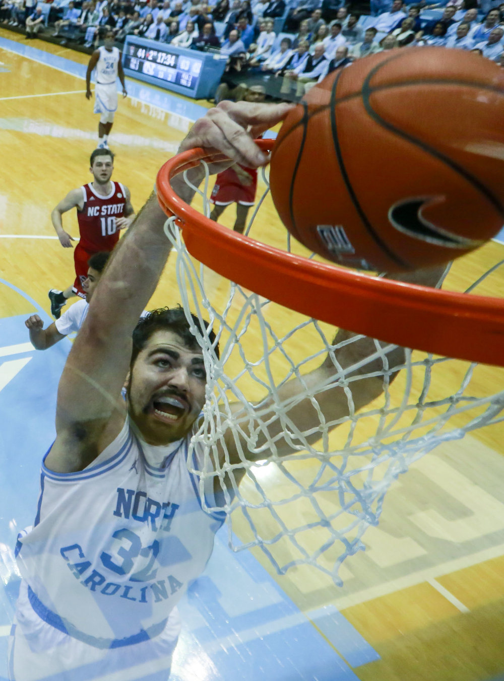 Noted Wolfpack killer Luke Maye dunks home two of his 31 points against N.C. State. The senior forward has averaged 29.0 points and 13.0 rebounds against the Wolfpack the last two years. | Photo by Alex Kormann