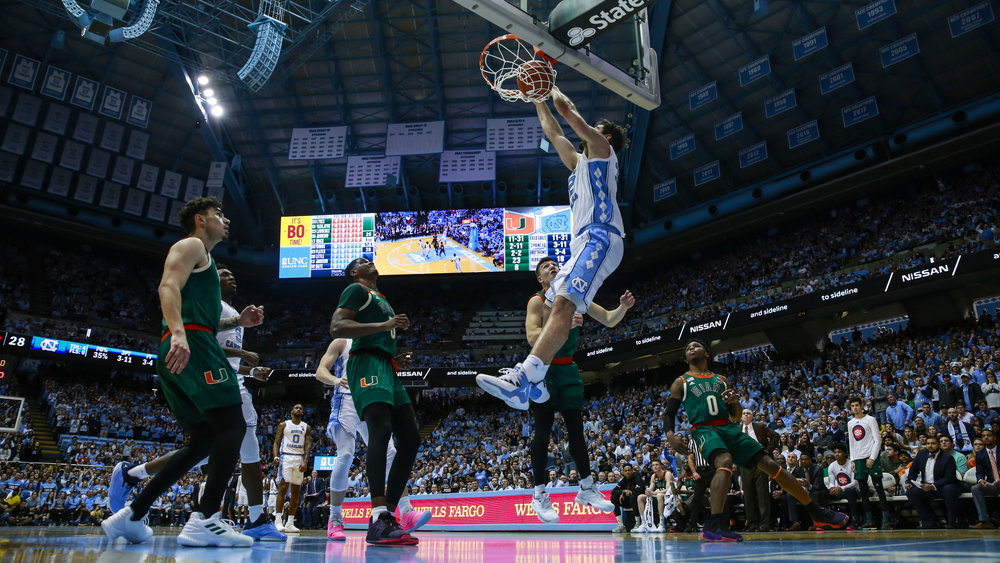 Luke Maye finishes off a dunk late in the first half of UNC's win over Miami. The senior forward finished with 20 points, none bigger than his game-tying three pointer to go to overtime at the end of regulation. | Photo by Alex Kormann