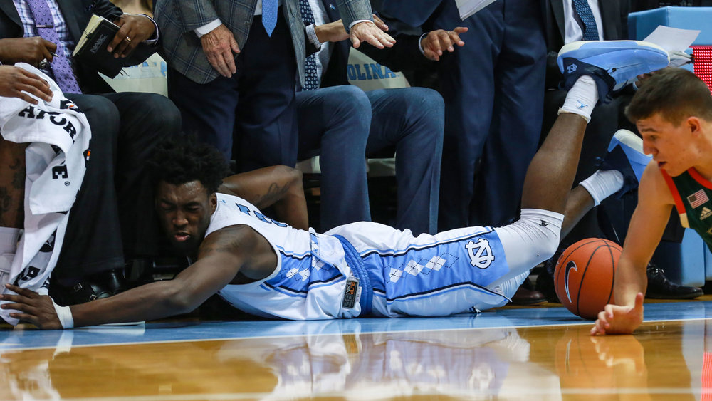 Nassir Little dives out of bounds attempting to recover a loose-ball. The freshman had ten points off the bench for the Tar Heels on Saturday. | Photo by Alex Kormann.