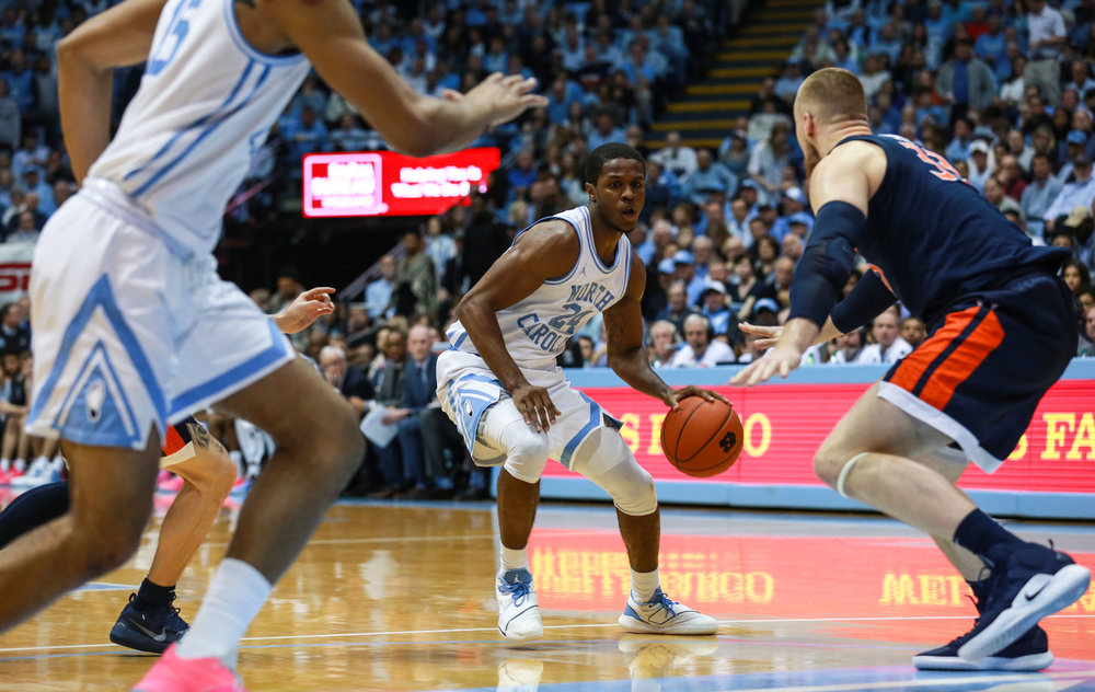 Kenny Williams handles the ball at the top of the key for UNC. The senior guard put blame on himself post game for the loss, noting his defensive lapses guarding Kyle Guy down the stretch. | Photo by Alex Kormann