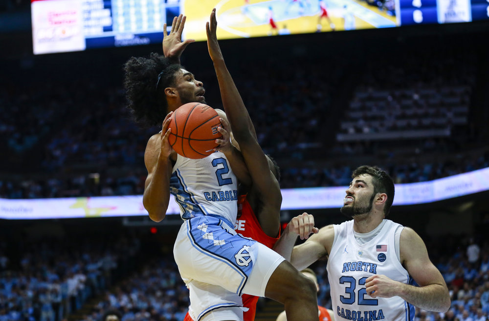 Freshman Coby White drives into the teeth of Syracuse's 2-3 zone. The freshman had 34 points on Tuesday night, becoming the first ever freshman at Carolina to have three 30+ point games (Texas, Miami) | Photo by Alex Kormann