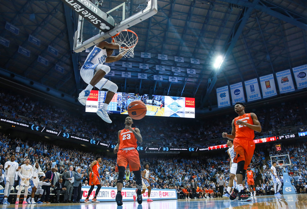 Kenny Williams' jam on the fast break glides to the floor for two of his eight points. The senior guard drew a charge in the start of the second half to spark UNC's 16-3 run. Williams leads the team in offensive fouls drawn with 19. | Photo by Alex Kormann