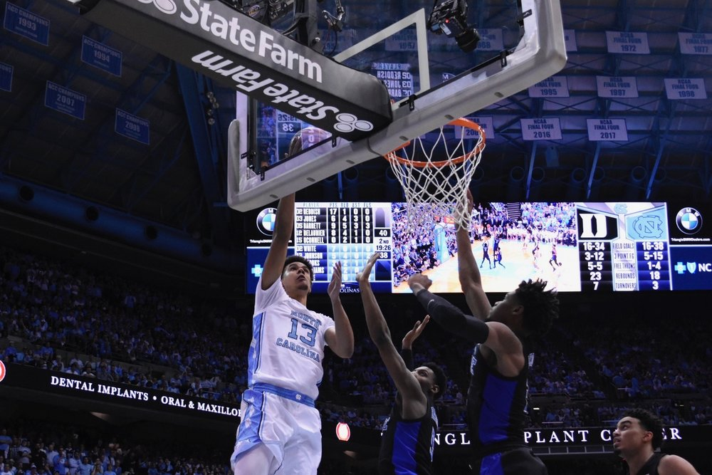 Cameron Johnson goes up for a layup against Duke. The graduate guard finished with 14 points and 10 rebounds in his final game in the Smith Center | Photo by Turner Walston