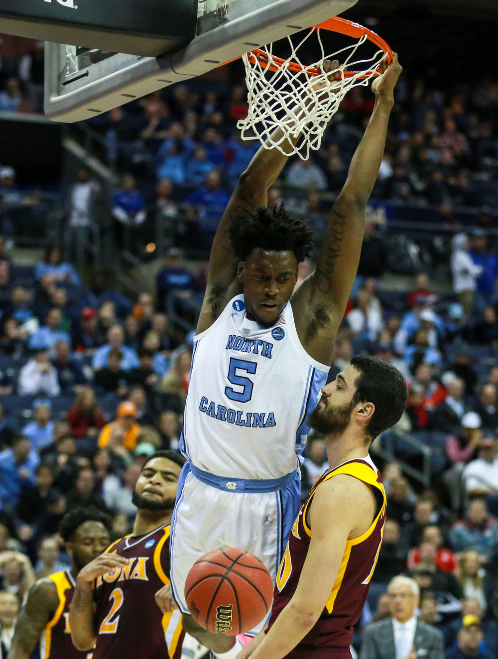 Nassir Little finishes off a dunk in the second half against Iona. The freshman forwards 19 points were the most for a UNC freshman in their NCAA tournament debut since Harrison Barnes' 24 points against LIU in 2011. | Photo by Alex Kormann