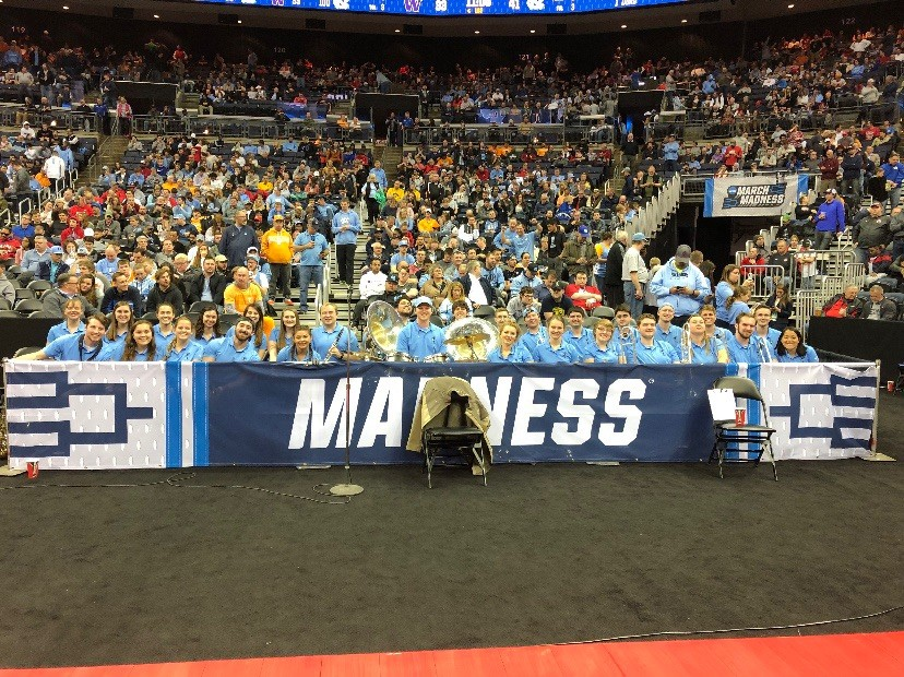 The UNC pep band smiles from their designated area along the baseline as they wait for halftime to end of North Carolina's Round of 32 game. (Photo courtesy of Jeff Fuchs)