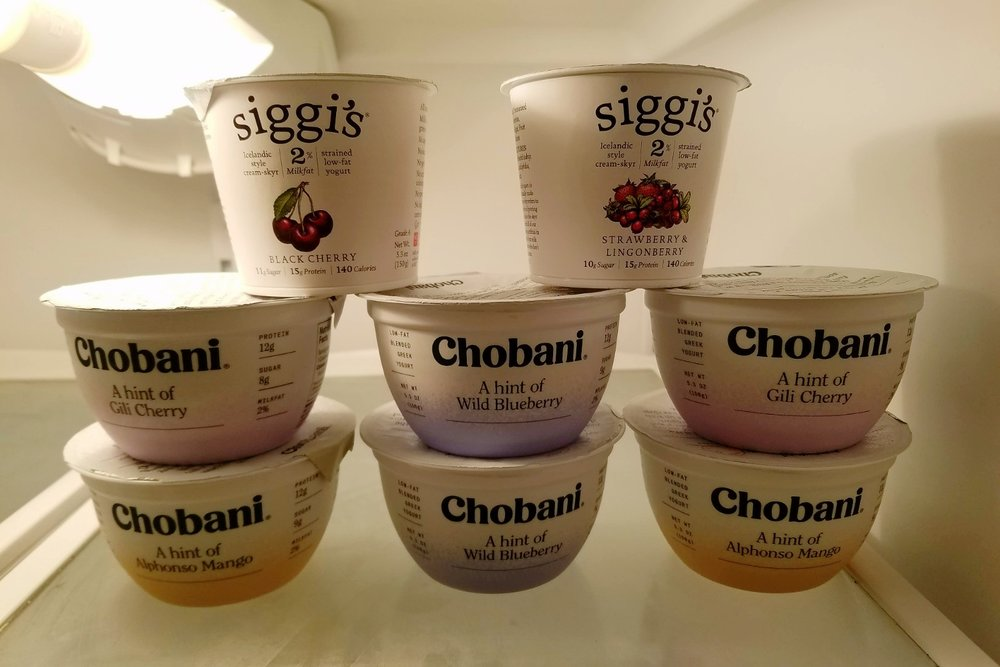 Chobani and Siggi's yogurts stacked in my fridge.