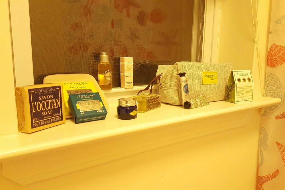 All of the products featured in the picture above are from L'Occitane en Provence, including the cosmetic pouch. Products listed from left to right:L'Occitan soap, Cedrat soap, L'Homme Cedrat soap, Almond shower oil, Neroli &Orchidee eau de toilette, Immortelle Precious eye cream, Verbena shower gel, 25% Shea Butter hand cream, Almond hand cream, and Balancing Infusion for Bath.