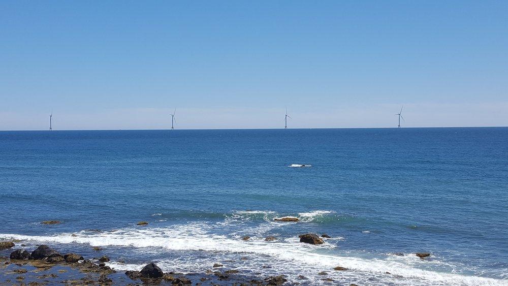 The Mohegan Bluffs on Block Island Energy Windmills