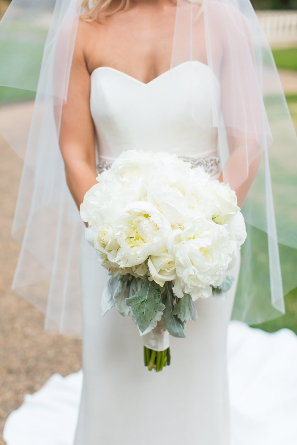 Anne's white peony bridal bouquet was designed by  Atlanta wedding florist Findlay Rowe Designs . It was the perfect arrangement for her sophisticated Southern wedding.
