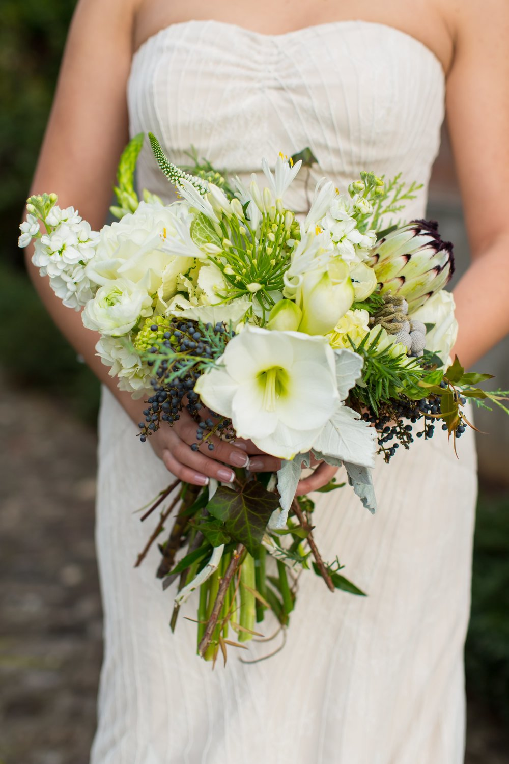 Kim wanted an organic, asymmetrical look for her bouquet, and  Atlanta florist Gertie Mae's Floral Design  delivered in a big way! It was the perfect design for her Alex and Kim's  Summerour wedding .