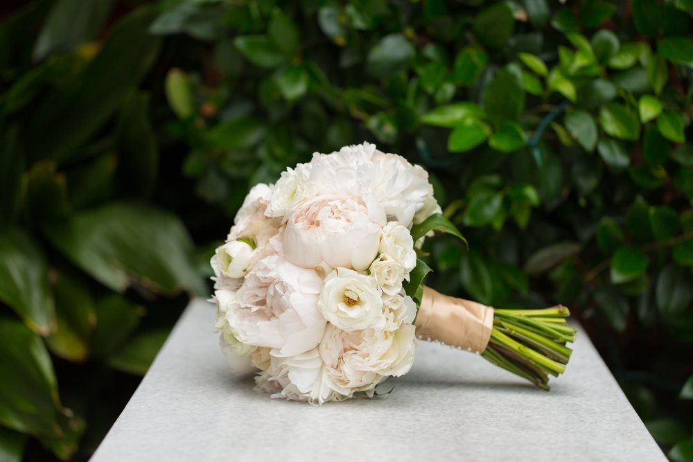 Muted blush peony bouquet by  Savannah wedding florist A to Zinnias . To view more from Evan and Audrey's  Mansion at Forsyth wedding, click here .