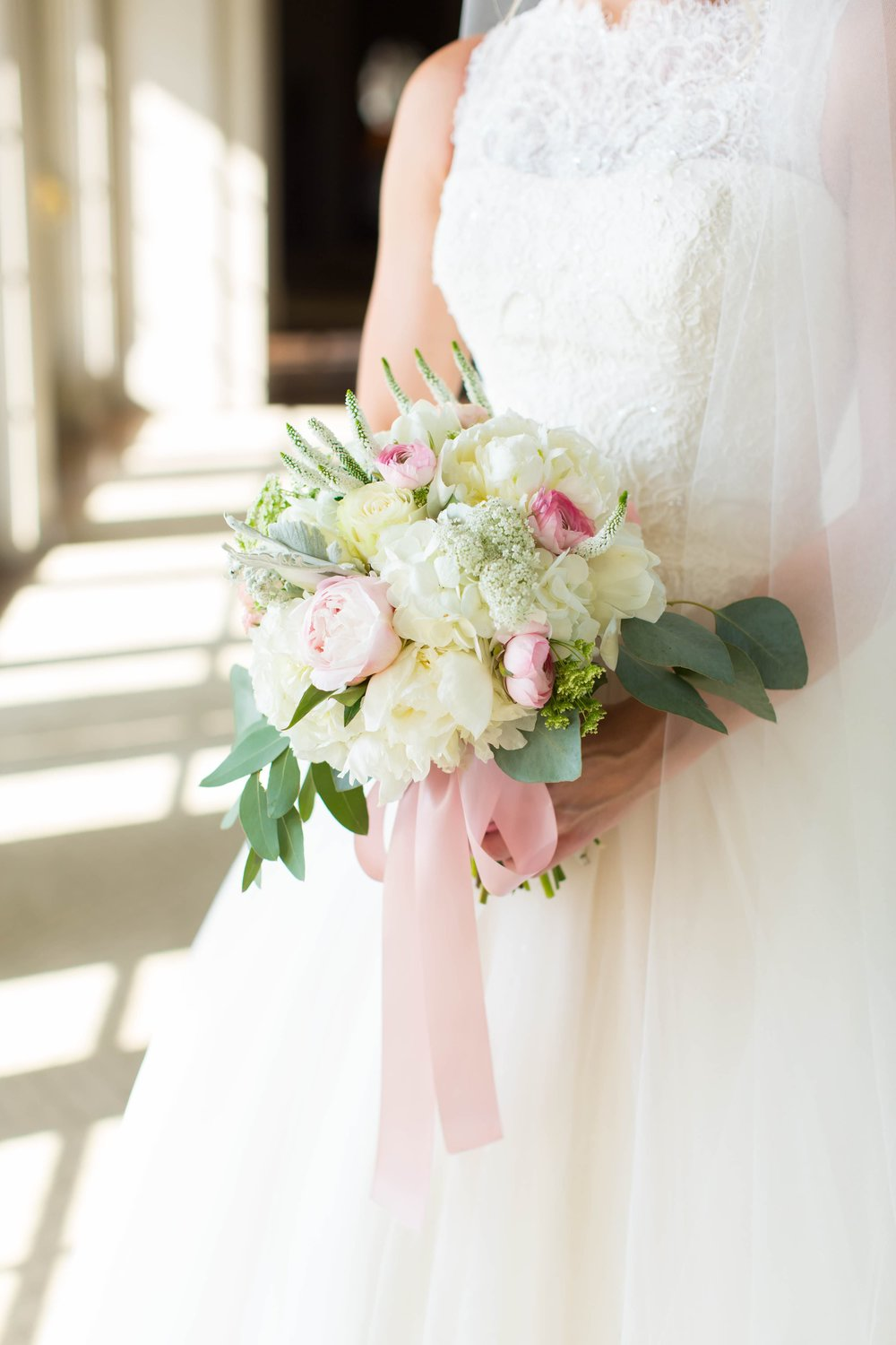 Where is the heart eyes emoji? Taylor's bridal bouquet was the epitome of all things feminine. The texture of the peonies and the color of the ribbon make this bouquet so stunning! To view more from Gamble & Taylor's  Piedmont Driving Club wedding, click here .