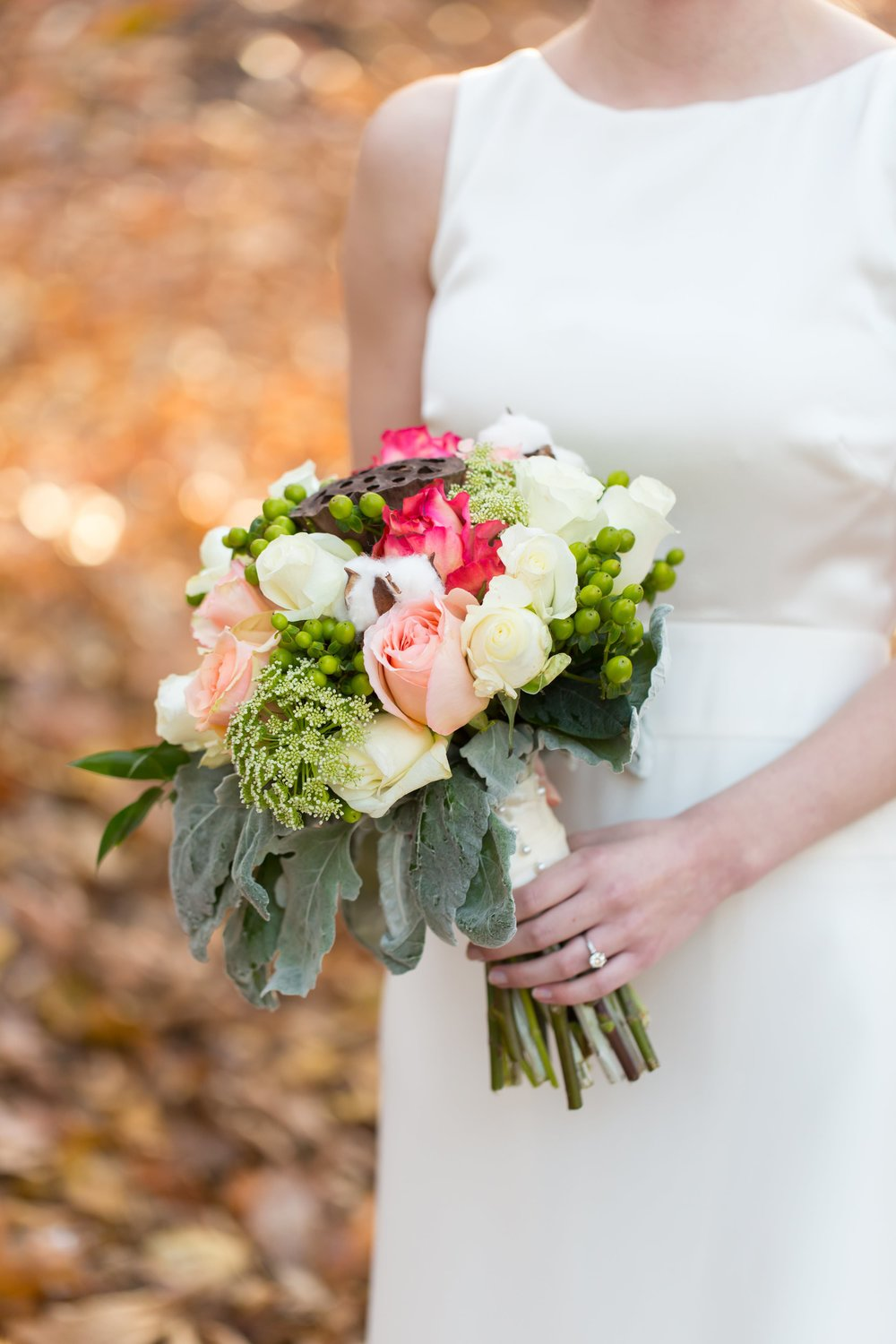 Jeff and Laura got married on Jeff's family cotton farm, so of course her Southern bouquet featured fresh cotton! I love the texture and warm tones of her bouquet. To view more from Jeff and Laura's  intimate Alabama farm wedding, click here .