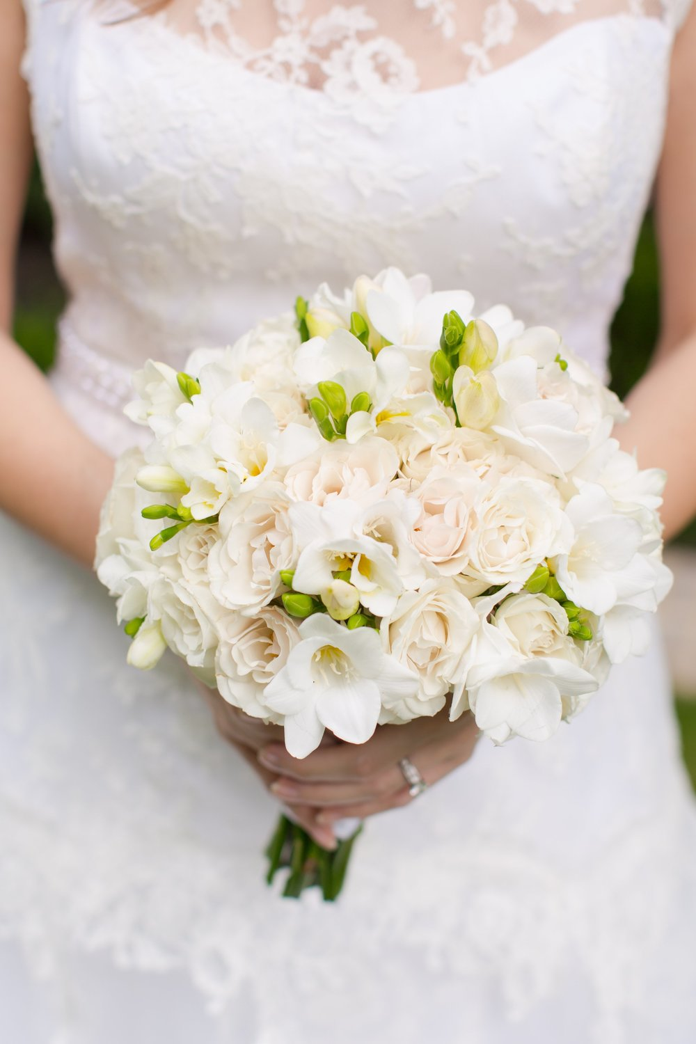 Marianna wanted a timeless look for her wedding, and this classic cream bridal bouquet by  Atlanta wedding designer A Divine Event  was the icing on the cake. To view more from Michael and Marianna's  classic Greystone at Piedmont Park wedding, click here .