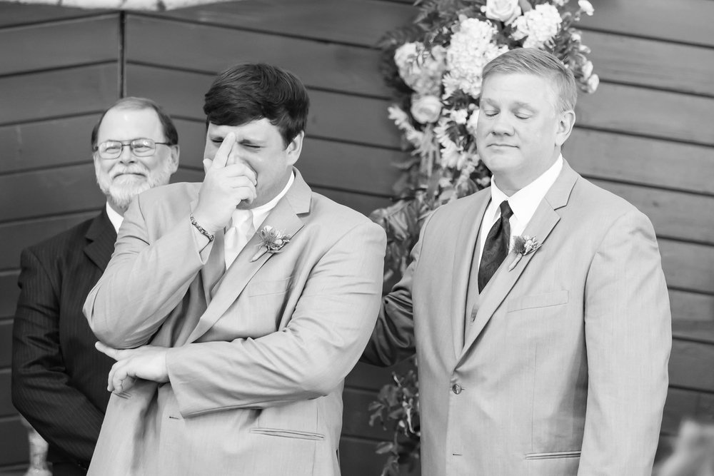 Whit could not hold it together when his bride walked through the doors of the stable at their  classic Southern wedding at Foxhall . I also love the smile on his pastor's face and the sweet connection his dad made with him when he reached over to place a hand on his shoulder.
