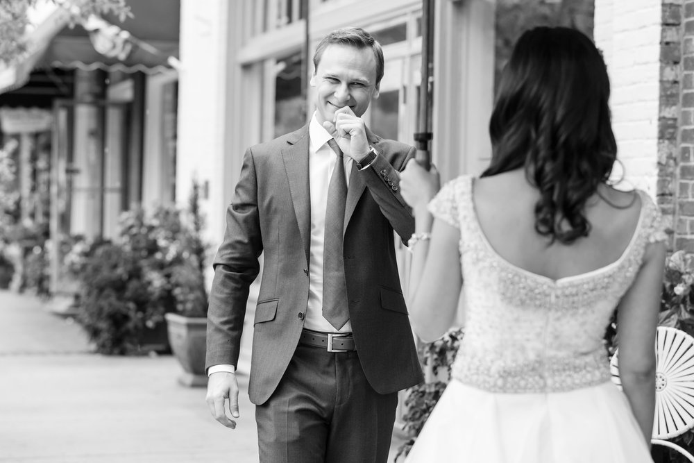 The rain couldn't dampen this groom's excitement at seeing his bride for the first time on his wedding day!