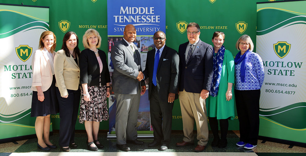 Motlow State Community College administrators Cheryl Hyland, left, Melody Edmonds and Hilda Tunstill flank new Motlow president, Michael L. Torrence, as MTSU President Sidney A. McPhee and fellow administrators Mark Byrnes, Laurie Witherow and Deb Sells attend the signing of a memorandum of understanding between the two schools that will benefit Motlow graduates who transfer to MTSU. (MTSU photo by Andy Heidt)