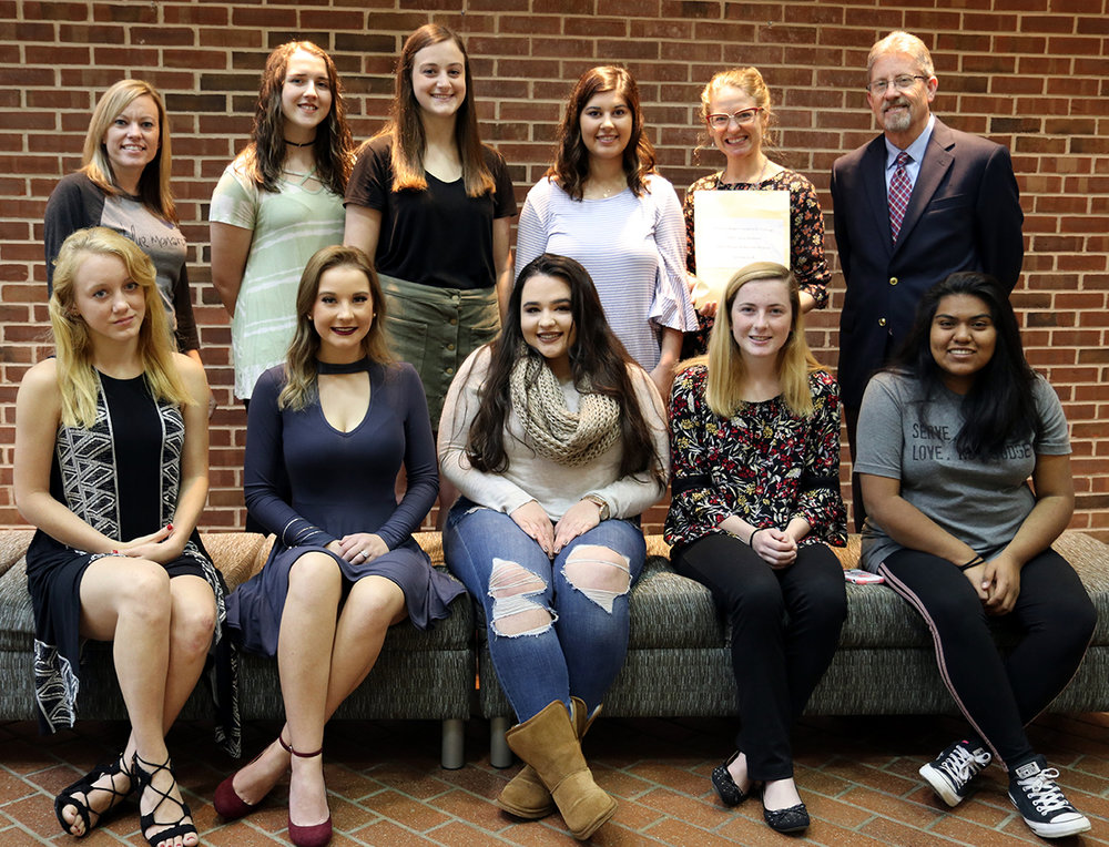 Pictured above are class members, front row from left, Sybrina McGinnis, Jamie Money, Savannah Whitaker, Summer Pritchard, and Rosario Lopez. Back row from left, Deanna Barnes, Blue Monarch marketing manager; Lindsay Melton, Samantha Blanche, Lindsay Eslick, Kate Cataldo, Blue Monarch manager; and Dr. Stephen Guerin, Motlow Honors professor.Students not pictured: Jennifer Mills, Racheal Overman, Liz Kingery.