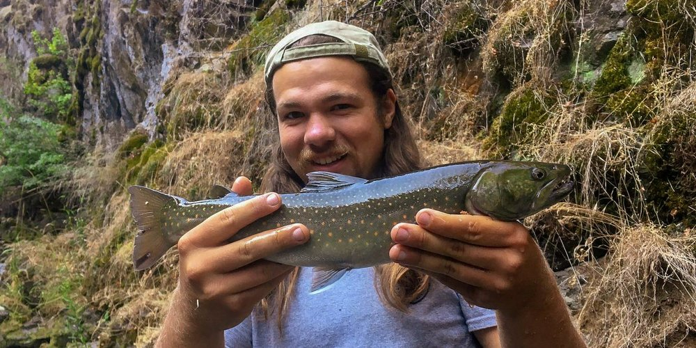 Parker Hildreth, a recent Motlow graduate from Smithville, holds a Bull trout on location in Idaho this summer, where he is serving as a biological aide for the Idaho Department of Fish and Game.