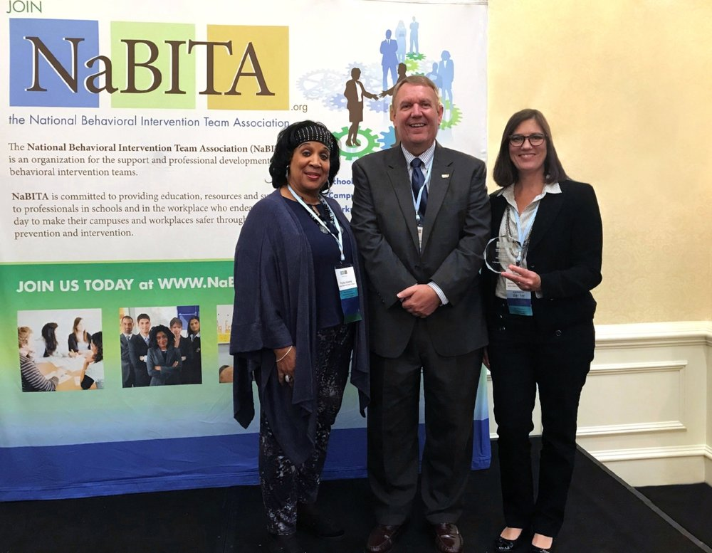 The Motlow Crisis Assessment and Risk Evaluation (CARE) Team recently received the National Behavioral Intervention Team Association's (NaBITA) 2018 Best Practices Institutional Impact Award at the NaBITA Conference in San Antonio. Pictured above are Motlow CARE Team members, from left, Dr. Phyllis Adams, professor of communications; and far right, Kirsten Moss-Frye, dean of students. With Moss-Frye and Adams is Dr. Chip Reese, NaBITA president, and assistant vice president for student affairs, and dean of students, at Columbia State University. Photo provided.