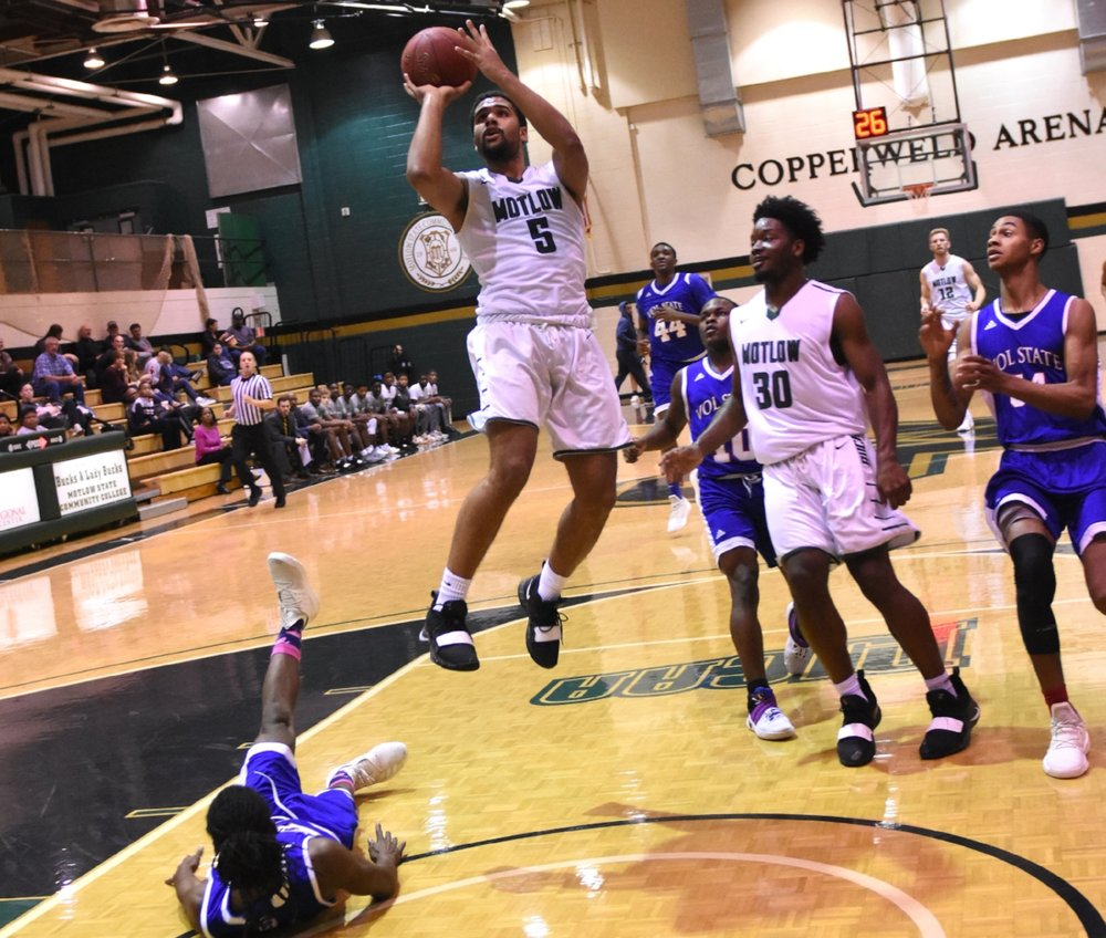 Motlow's Darius Harding (5), a freshman guard from Elizabethtown, Ky., puts up a shot while teammate Marcus Lacey gets in position for the rebound during Saturday's 84-58 win over Volunteer State at Copperweld Arena. Harding leads the team in scoring, averaging 16.1 points per game.  Photo by Jeff Reed Photography.