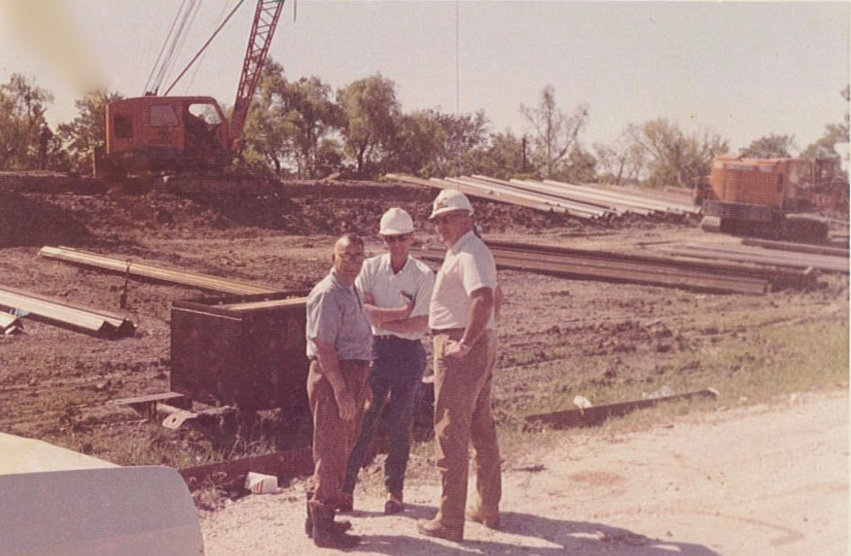 Fred A. Settoon - (middle) white shirt, blue pants