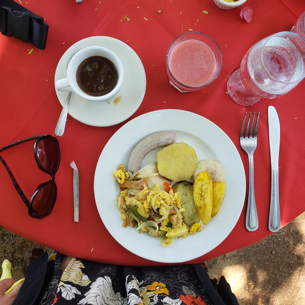 Ackee & Codfish breakfast with banana, plantain, festival, & bammy with a Blue Mountain coffee & fresh guava juice from  Jake's Hotel  in Treasure Beach.