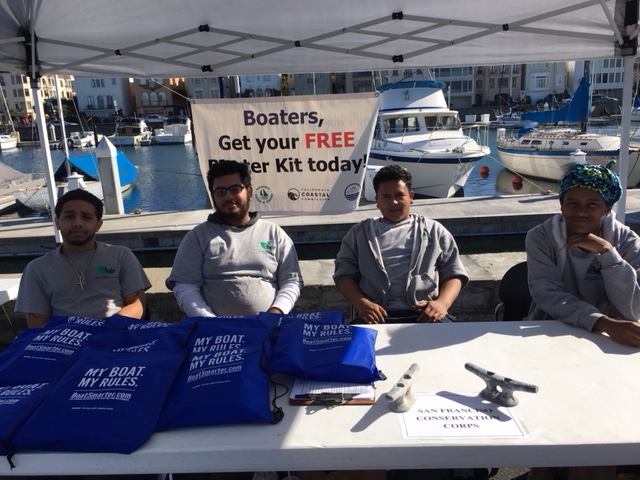 Corpsmembers Frank, John, Chris, and Issis tabling at the SF Marina small craft harbor.