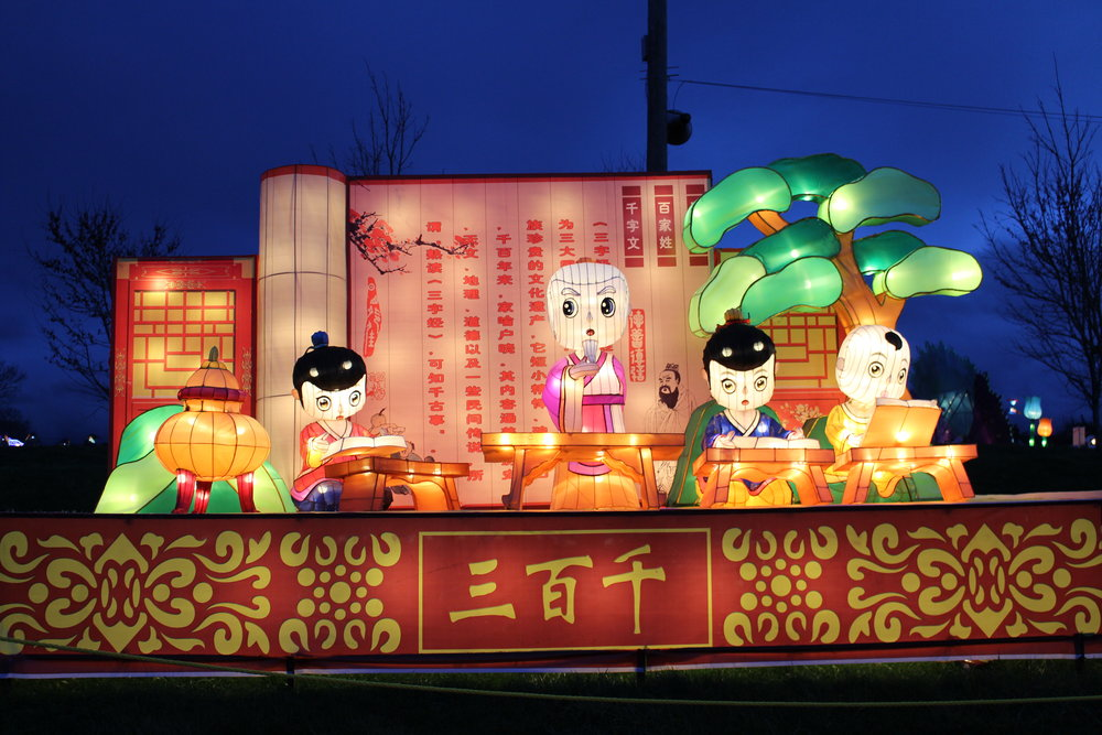 "This display shows young children reading the ""Three Character Classic,"" a traditional piece of reading for young children in China."