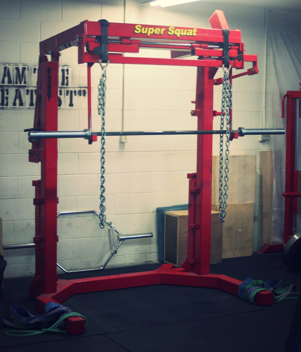 Monolift - This piece of equipment allows for squatting heavy weight without needing to walk out. After lifting the barbell, the hooks swing out of the way so the lifter can perform a squat in place. Resistance bands are around the base to help introduce variation into your squats.