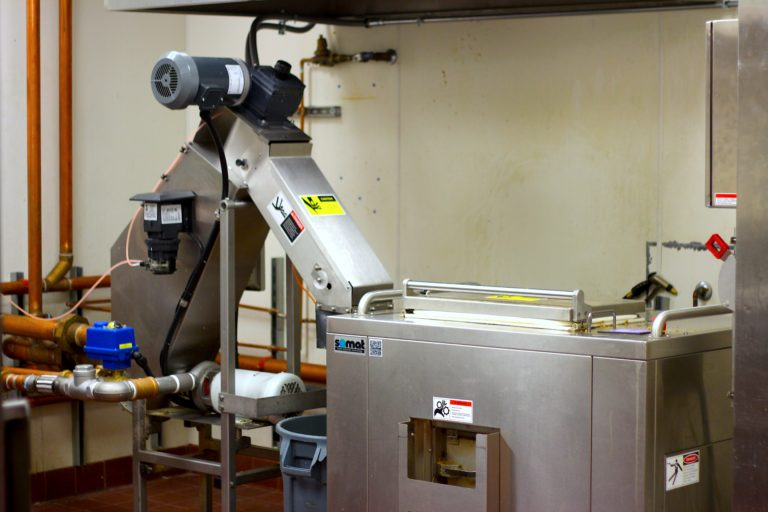 It looks innocent enough, but this powerhouse of a machine, pulps, grinds and dehydrates every bit of food waste from the NAU dining halls preparing it to become compost.
