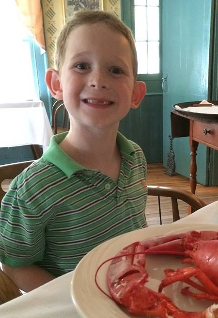 Micah conquering a lobster July 2015.jpg