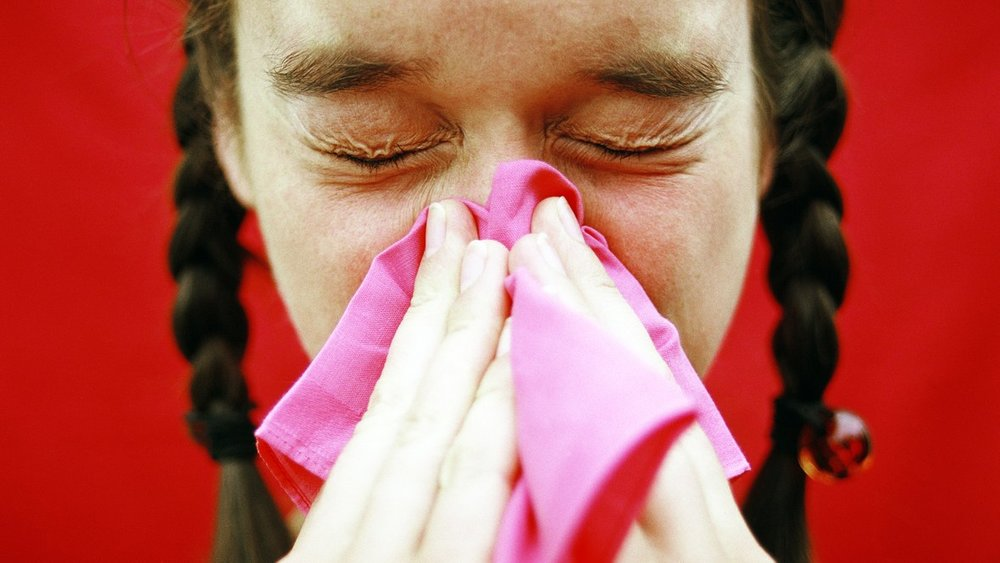 woman%20sneezing%20-%20getty%20images.jpg